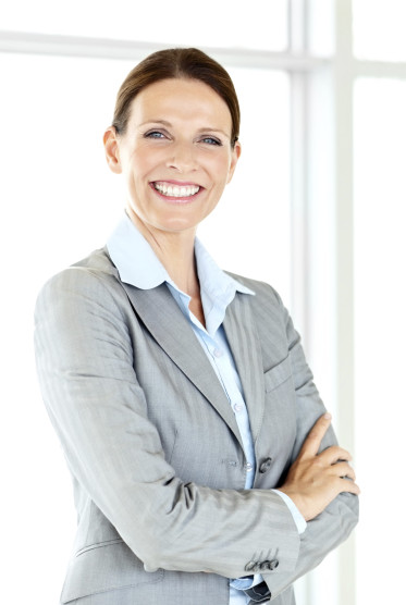 Portrait of a smiling confident business woman with hands folded